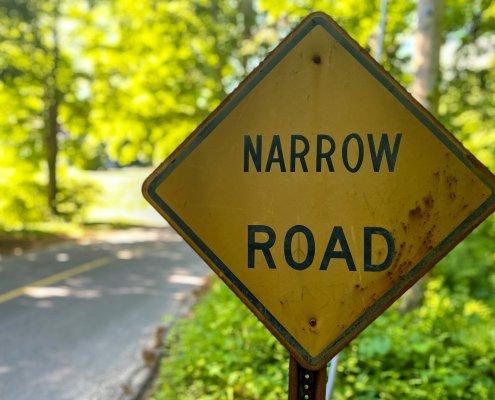 narrow road warning sign